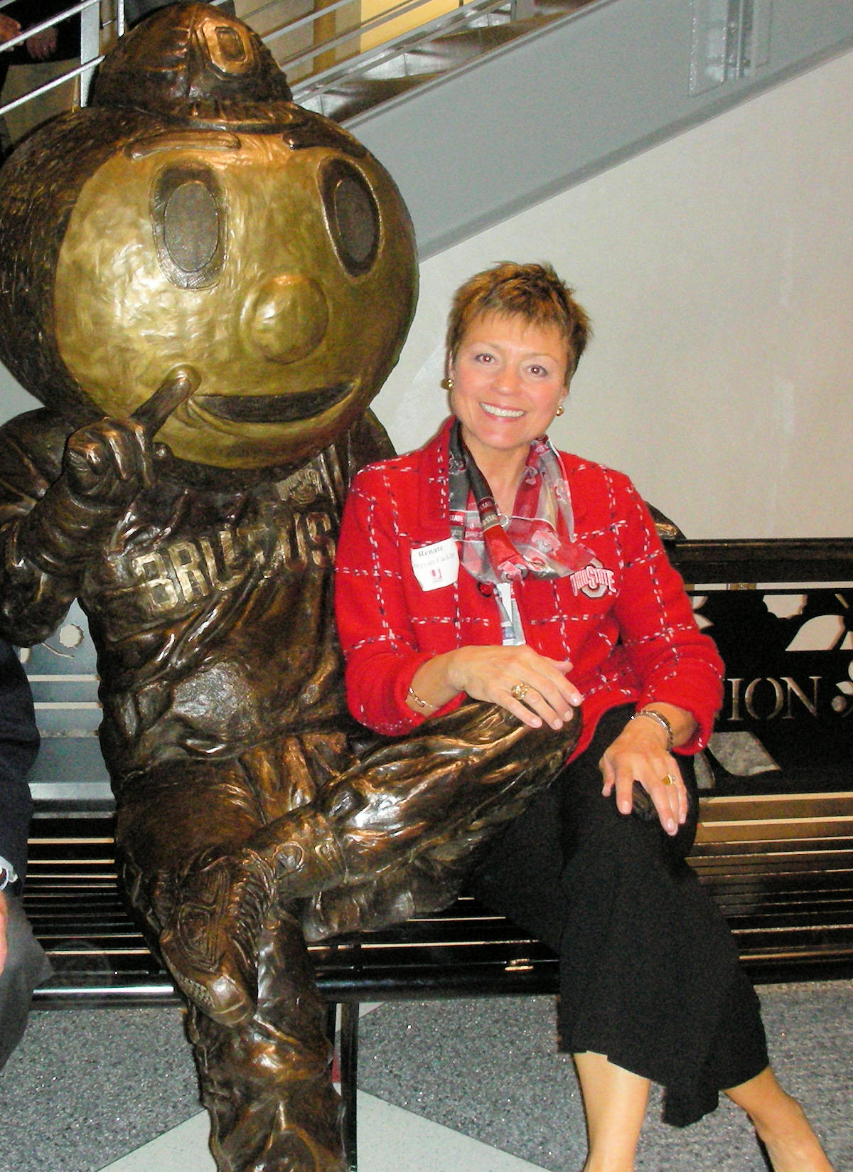 Renate Burgyan Fackler sitting next to Brutus Buckeye in The OSU union.